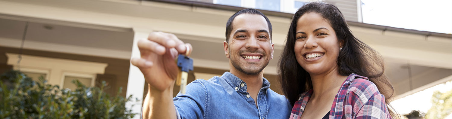 Credit Union Loans - Couple holding keys header image